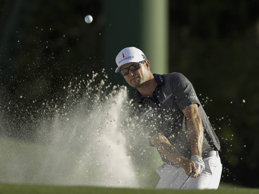 Zach Johnson hits on the 18th hole during the first round for the Masters golf tournament Thurs ...