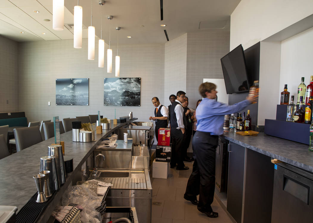 The bar is stocked in the Replenish Zone at the new 7,054 square foot The Club at LAS lounge in ...