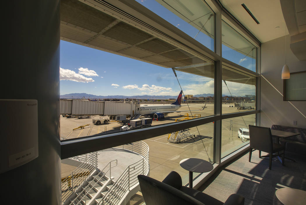 View of the tarmac from the Resting Zone in the new 7,054 square foot The Club at LAS lounge in ...