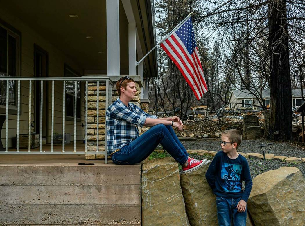 In this photo taken March 19, 2019, Dawn Herr and her son Liam, 8, visit their home in Paradise ...