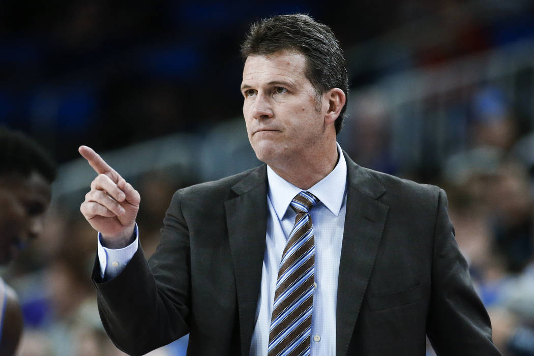 Former UCLA coach Steve Alford gestures during the team's NCAA college basketball game against ...