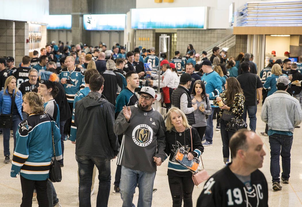 San Jose Sharks fans make their way to their seats before the start of game two of the NHL West ...