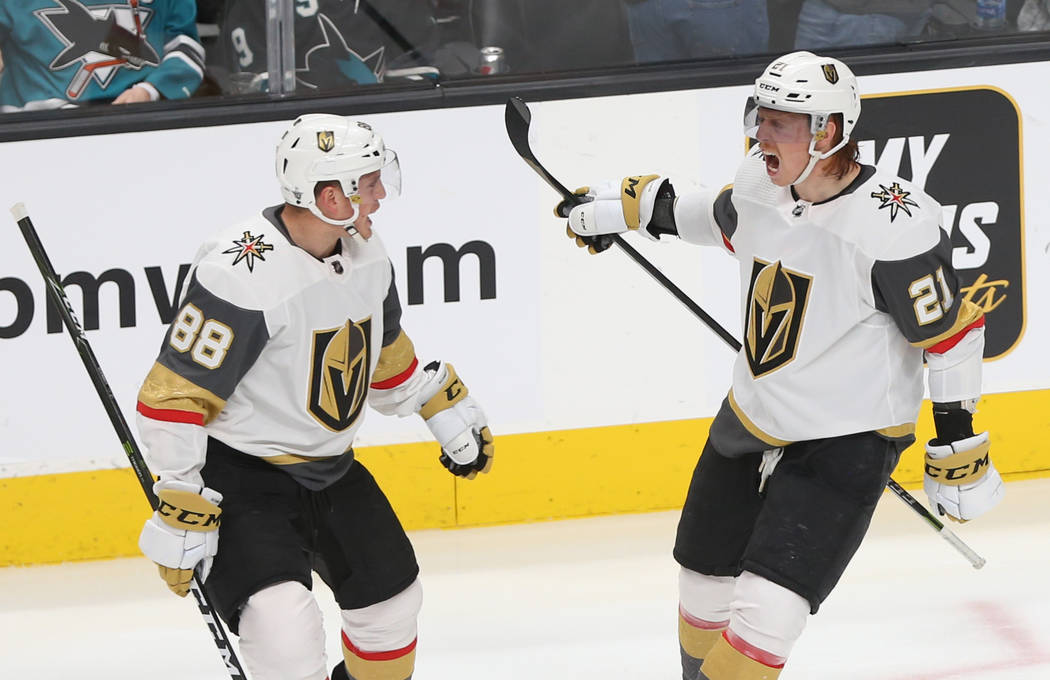 Golden Knights center Cody Eakin (21) celebrates with teammate Nate Schmidt (88) after scoring ...