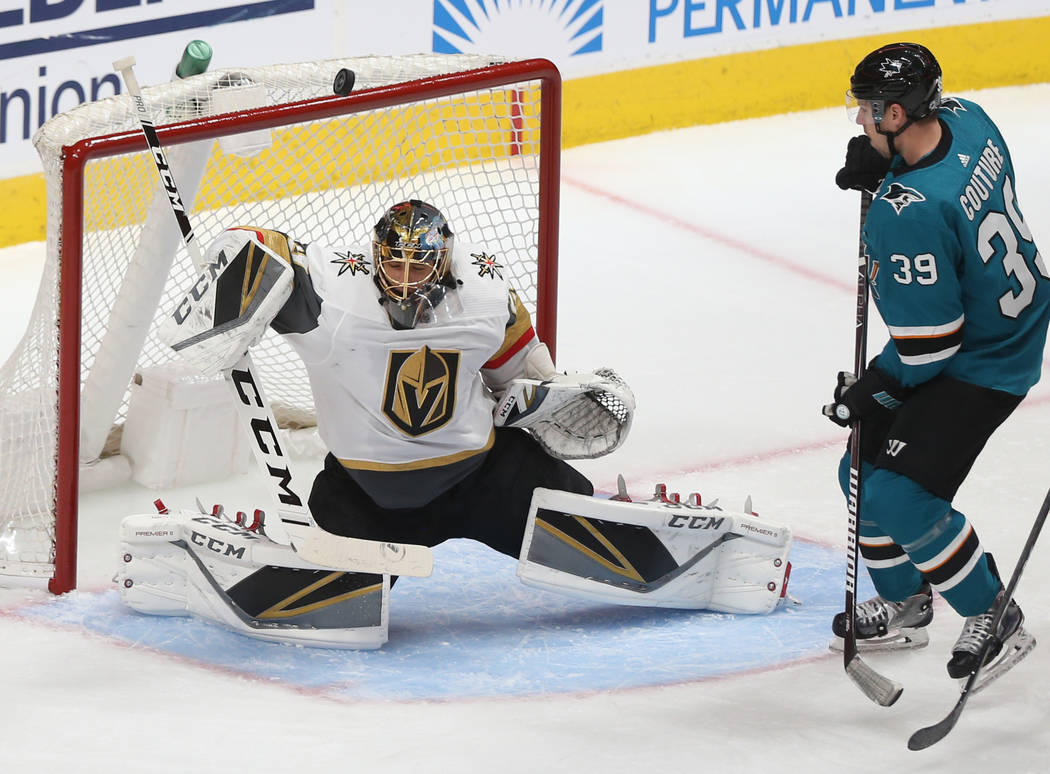Golden Knights goaltender Marc-Andre Fleury (29) makes a save against San Jose Sharks center Lo ...