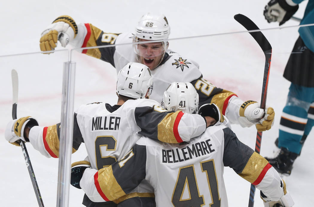 Golden Knights center Pierre-Edouard Bellemare (41) celebrates with teammates Paul Stastny (26) ...