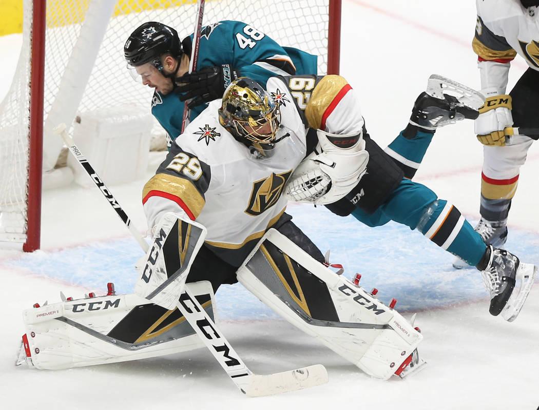 San Jose Sharks center Tomas Hertl (48) collides with Golden Knights goaltender Marc-Andre Fleu ...