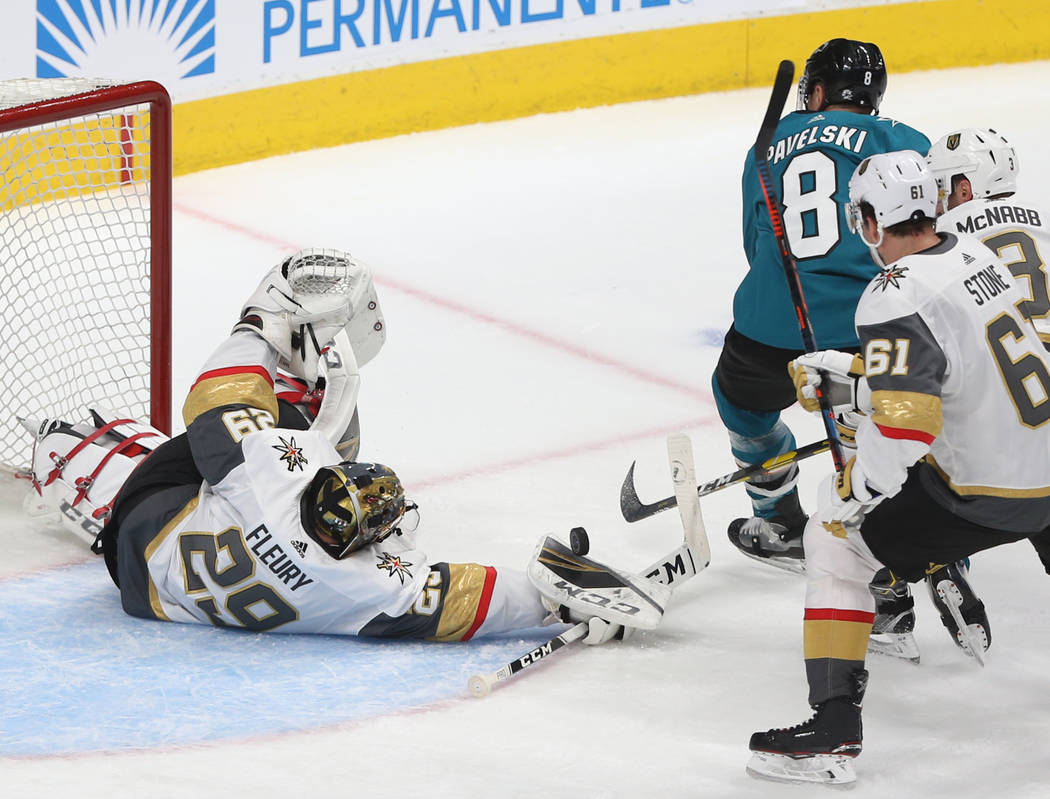Golden Knights goaltender Marc-Andre Fleury (29) makes a save against San Jose Sharks center Jo ...