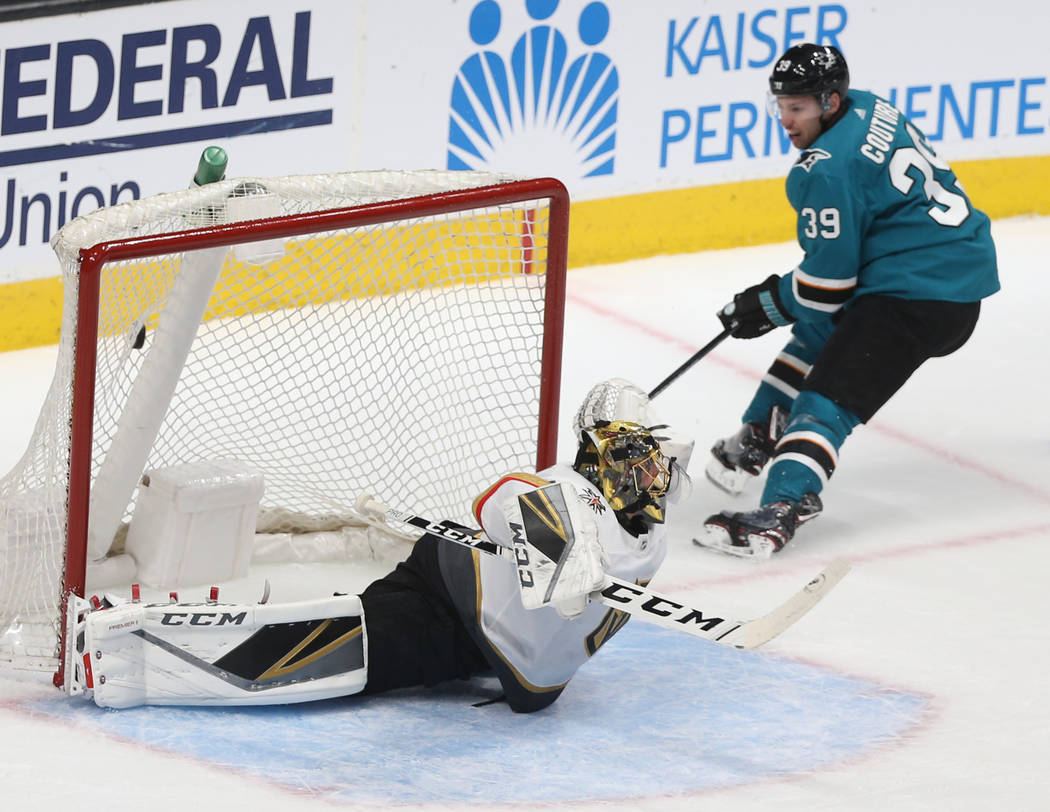 San Jose Sharks center Logan Couture (39) scores against Golden Knights goaltender Marc-Andre F ...