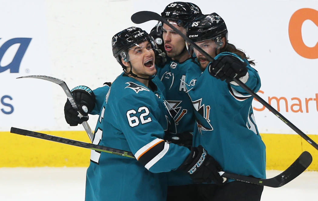 San Jose Sharks right wing Kevin Labanc (62) celebrates with teammates after center Logan Coutu ...