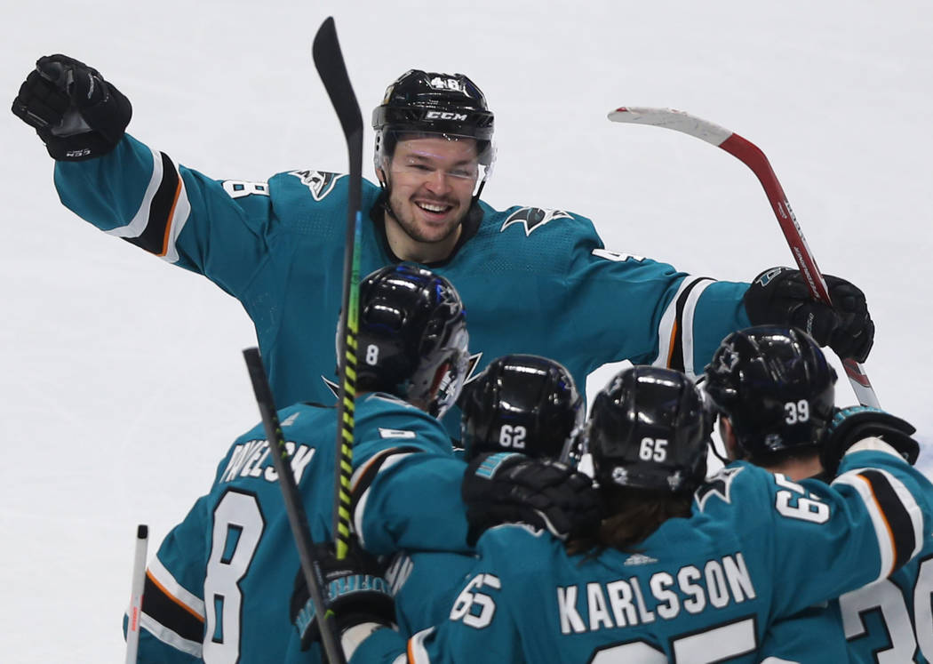 San Jose center Tomas Hertl (48) celebrates with teammates after the Sharks scored a goal in th ...