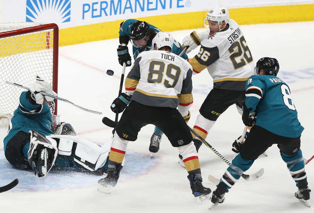 San Jose Sharks goaltender Aaron Dell (30) makes a save against Golden Knights right wing Alex ...