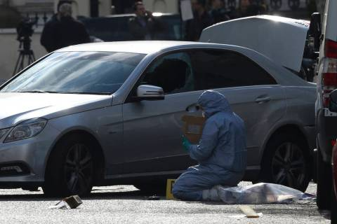 A Forensic officer works at the scene near the Ukrainian Embassy after police fired shots after ...