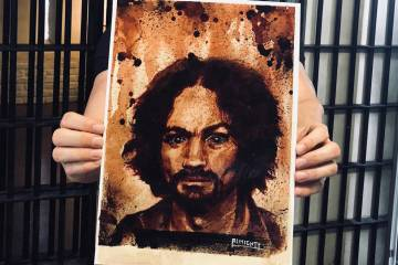 "Zak Bagans of ""Ghost Adventurers"" on Travel Channel shows a painting of Charles Manson, with Ma ..."