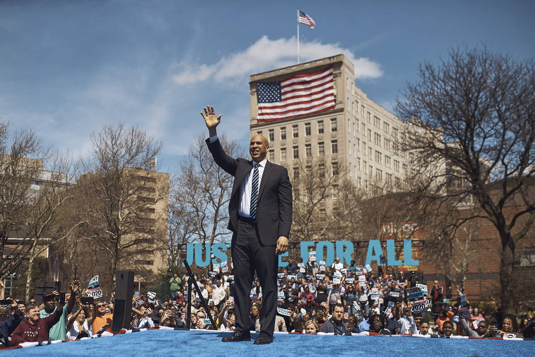 Democratic presidential candidate Sen. Cory Booker, D-N.J. salutes the crowd during a hometown ...
