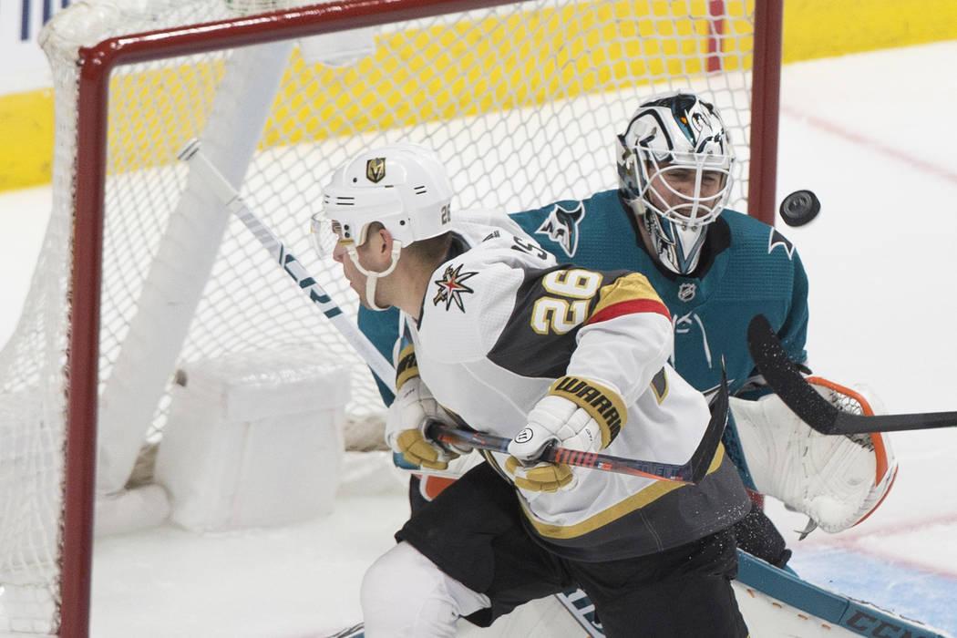San Jose Sharks goaltender Martin Jones (31) makes a save against Golden Knights center Paul St ...