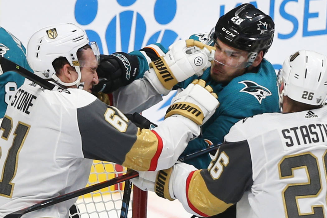 Golden Knights right wing Mark Stone (61) fights San Jose Sharks right wing Timo Meier (28) in ...
