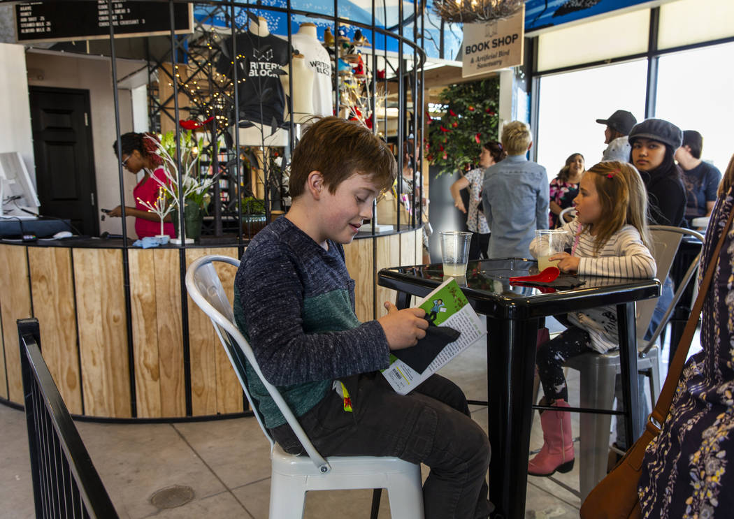 Nigel Henderson, 9, and sister Greta, 7, enjoy the new coffee shop during the launch of The Luc ...