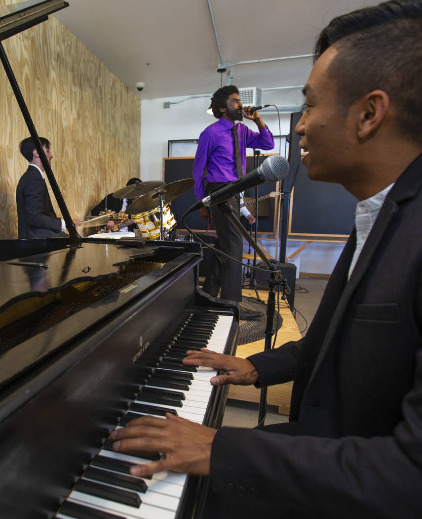 The Lique band entertains the guests on hand during the launch of The Lucy and grand opening of ...