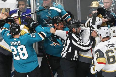 San Jose Sharks right wing Timo Meier (28) and left wing Evander Kane (9) fight with Golden Kni ...
