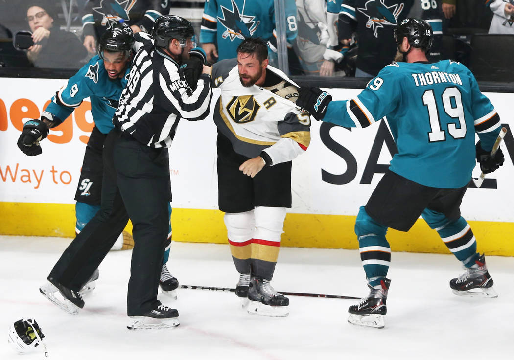 San Jose Sharks left wing Evander Kane (9) and center Joe Thornton (19) fight with Golden Knigh ...