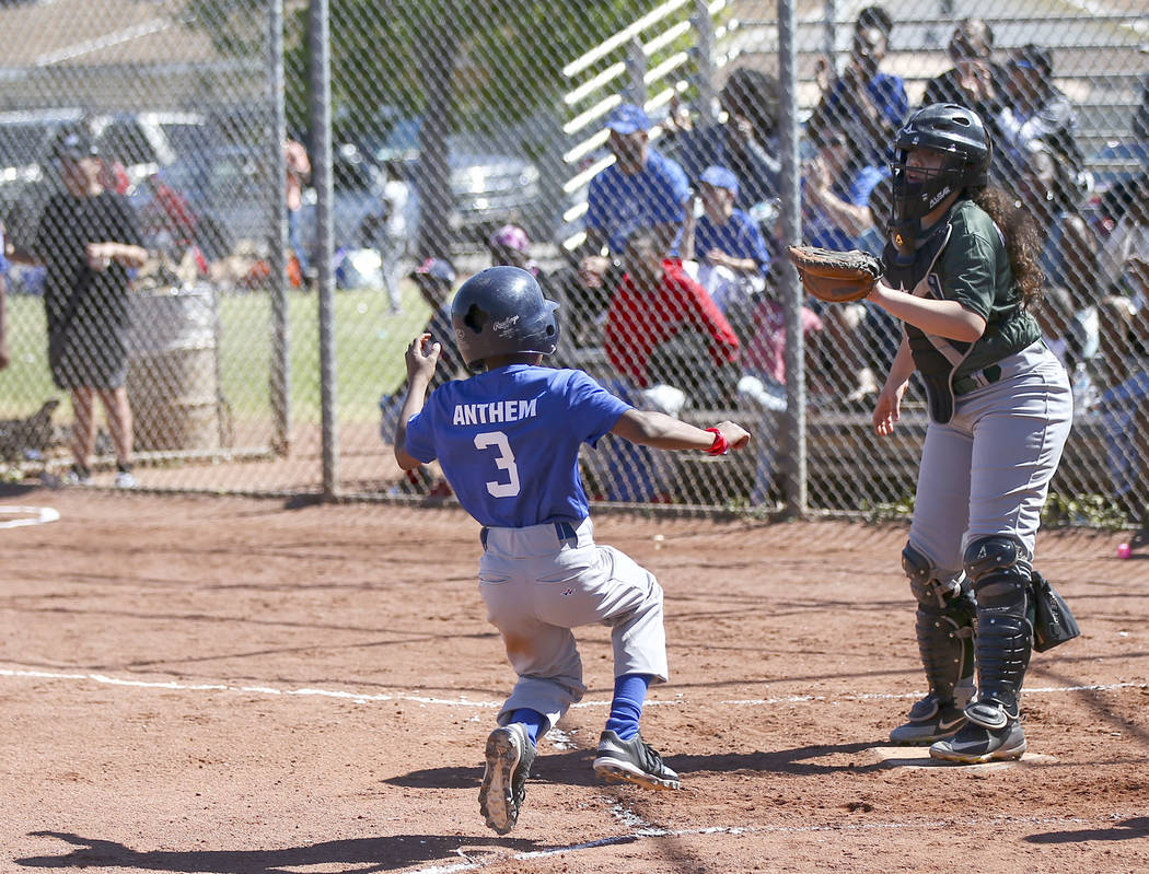 Rangers' Jay Jay Nichols, 12, scores a run against the Bulldogs during the opening day celebrat ...