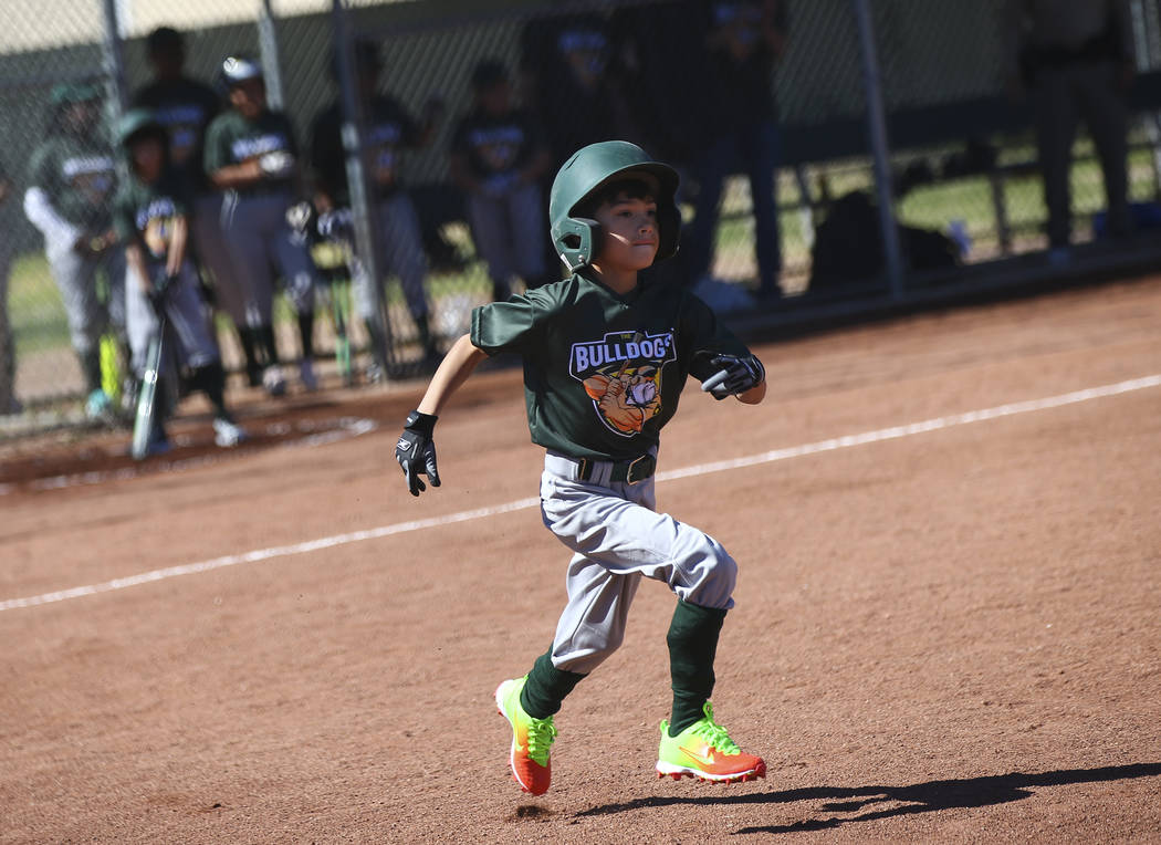 Bulldogs' Nathan Pineda, 9, runs to first base while playing against the Rangers during the ope ...