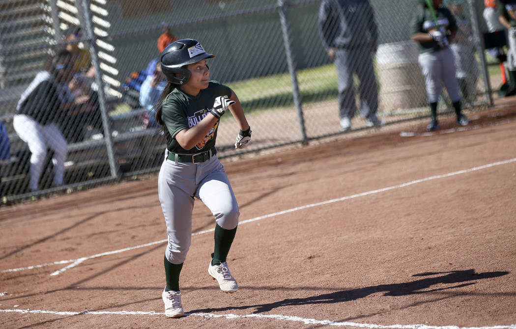 Bulldogs' Karen Guardado, 12, runs to first base while playing against the Rangers during the o ...