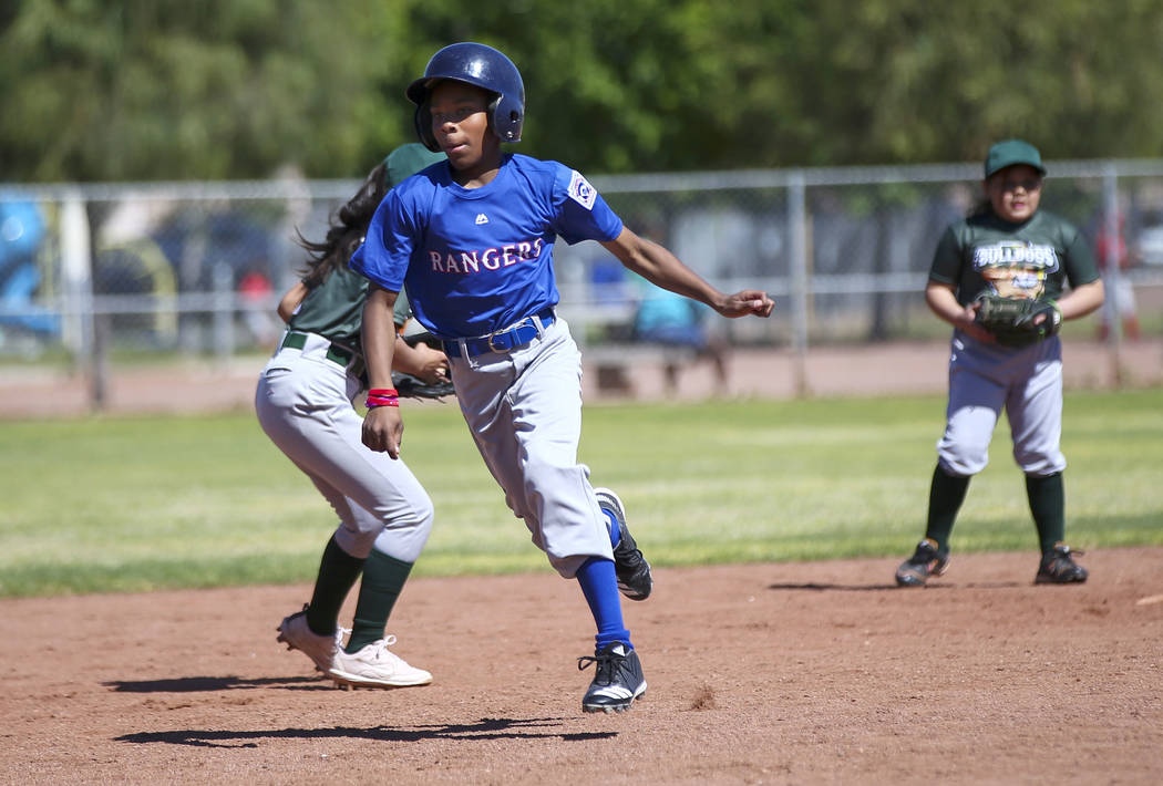 Rangers' Jay Jay Nichols, 12, runs to third base against the Bulldogs during the opening day ce ...