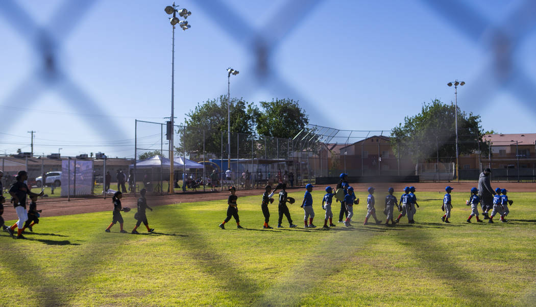 Players walk out onto the field during the opening day celebration for the third season of Bold ...