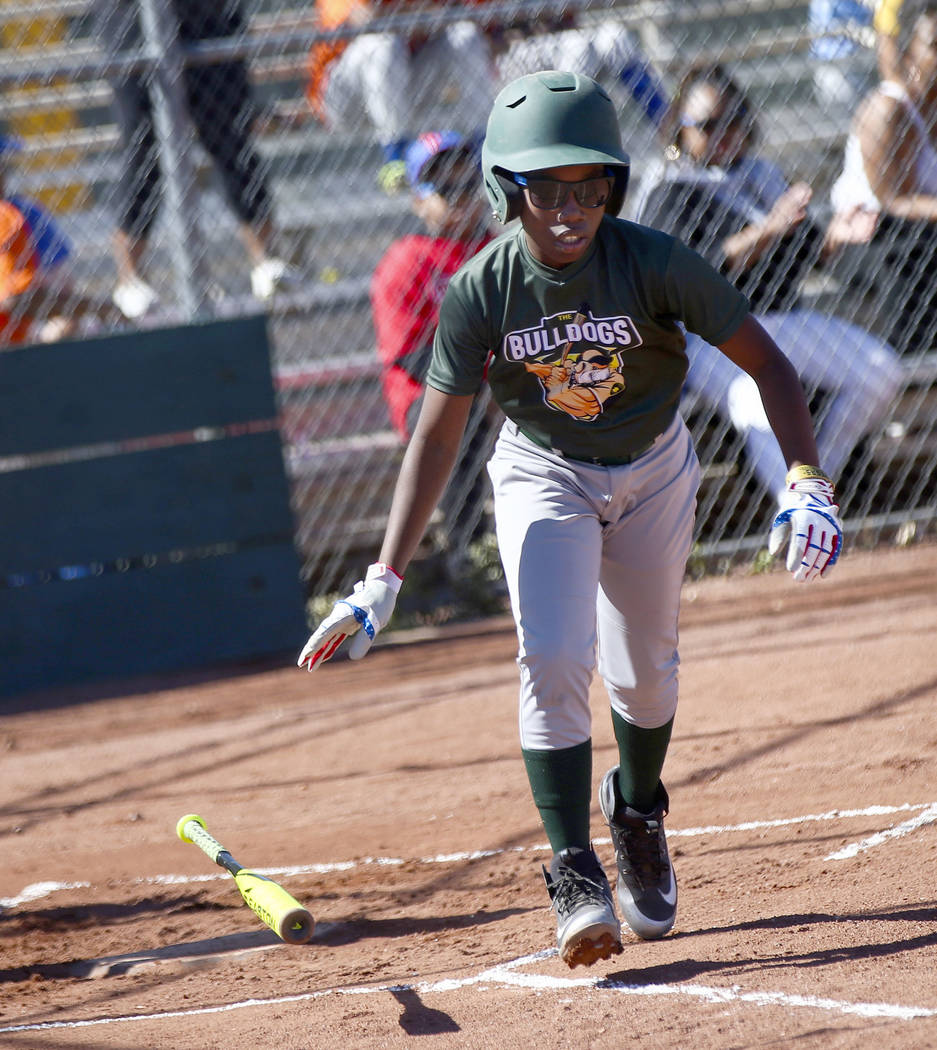 Bulldogs' Marcel Elzy, 12, runs to first base while playing against the Rangers during the open ...