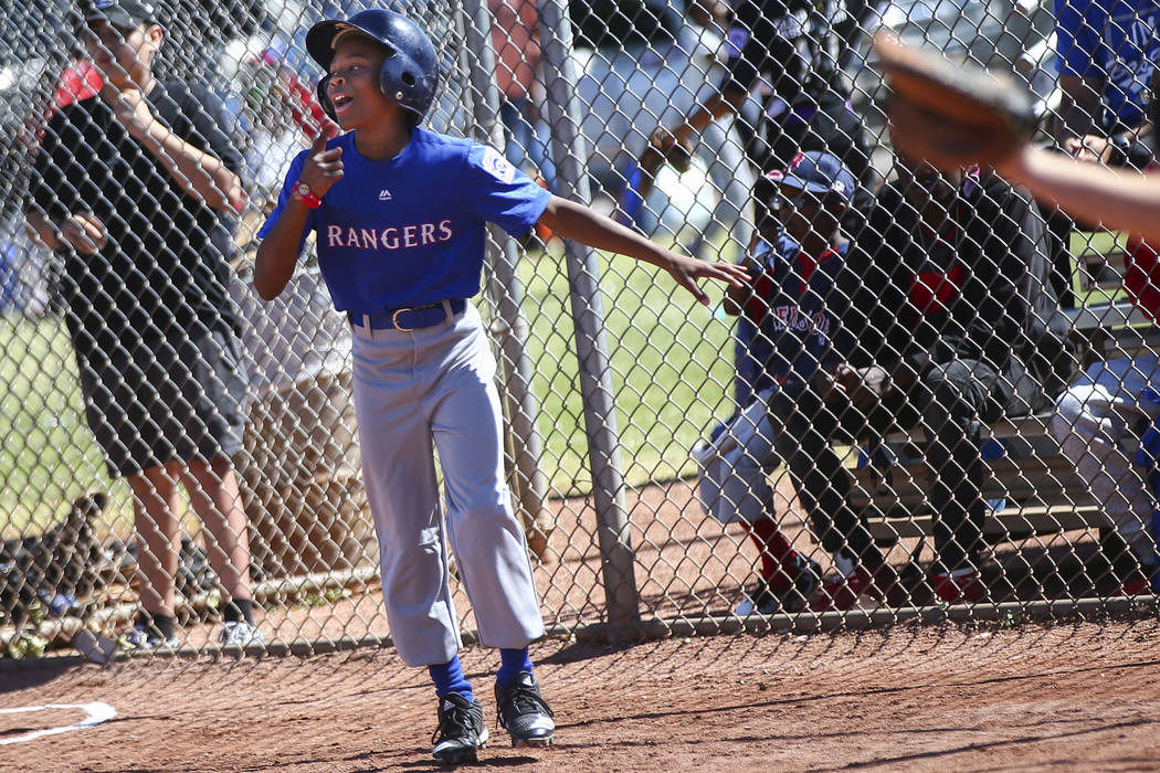 Rangers' Jay Jay Nichols, 12, celebrates after scoring a run against the Bulldogs during the op ...