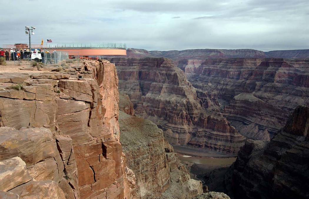 The Skywalk is slowly moved out over the rim of the Grand Canyon before a throng of VIP guests ...
