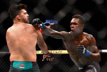 Kelvin Gastelum and Israel Adesanya fight during a middleweight mixed martial arts bout at UFC ...