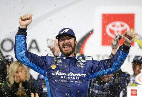 Martin Truex Jr. (19) celebrates winning the NASCAR Cup series auto race at Richmond Raceway in ...