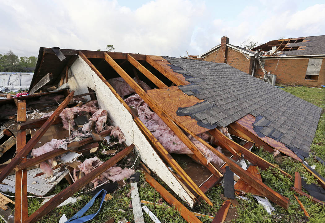 A roof a home that was blown off a home rests on the ground in Hamilton, Miss., after after a d ...