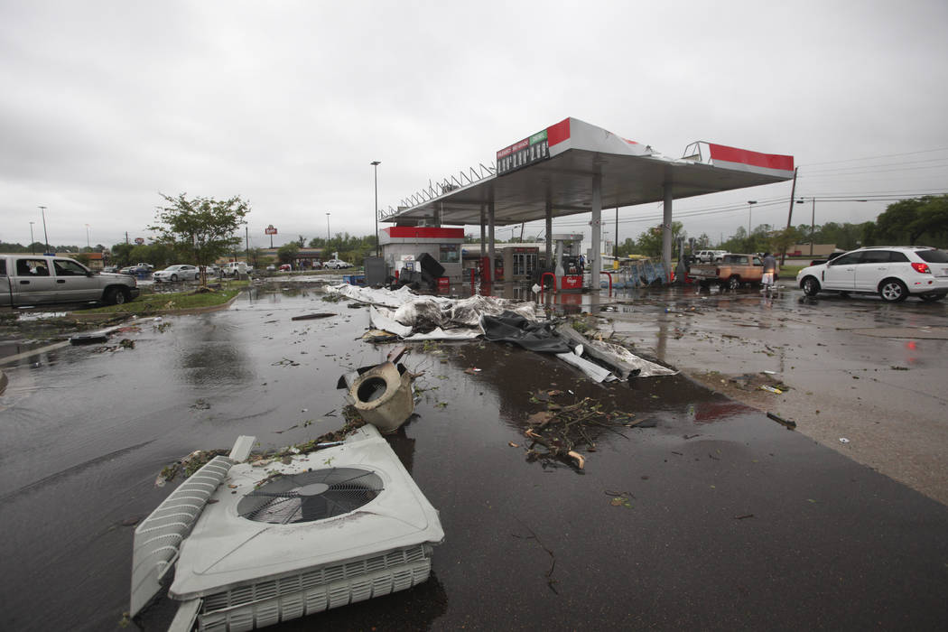 A gas station is damaged following severe weather, Saturday, April 13, 2019 in Vicksburg, Miss. ...