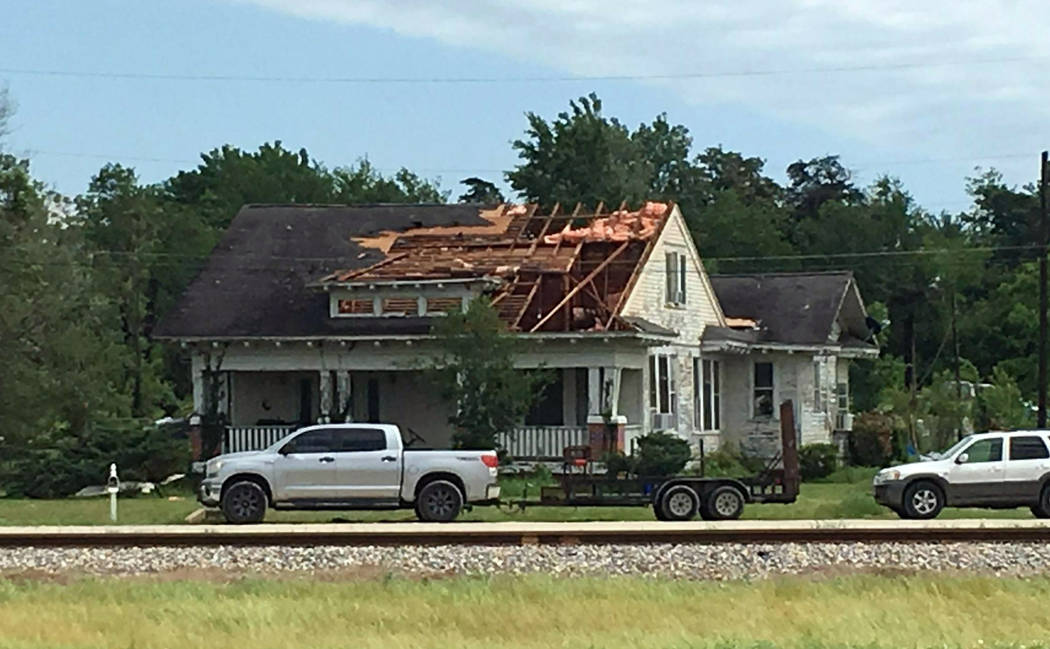 A roof is torn off a home following a suspected tornado, Saturday, April 13, 2019 in Franklin, ...
