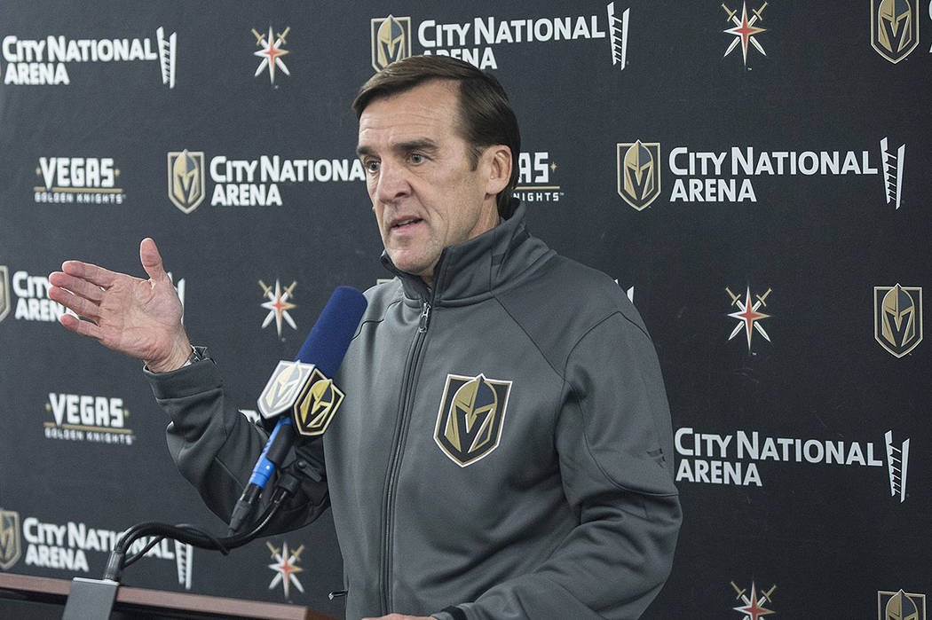 Golden Knights general manager George McPhee takes questions during a press conference after pr ...