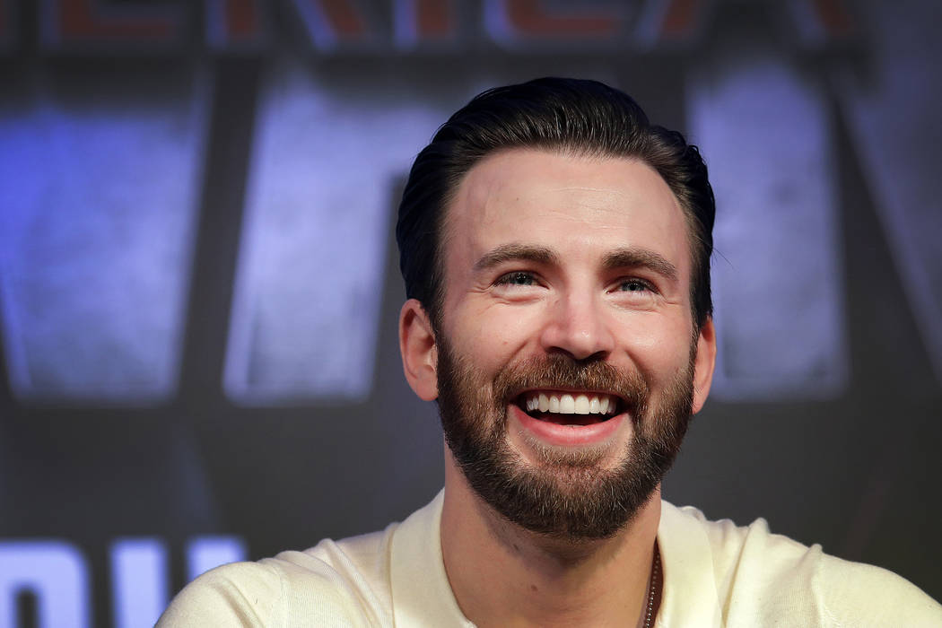 Chris Evans who plays the main character Steve Rogers or Captain America, speaks to members of ...