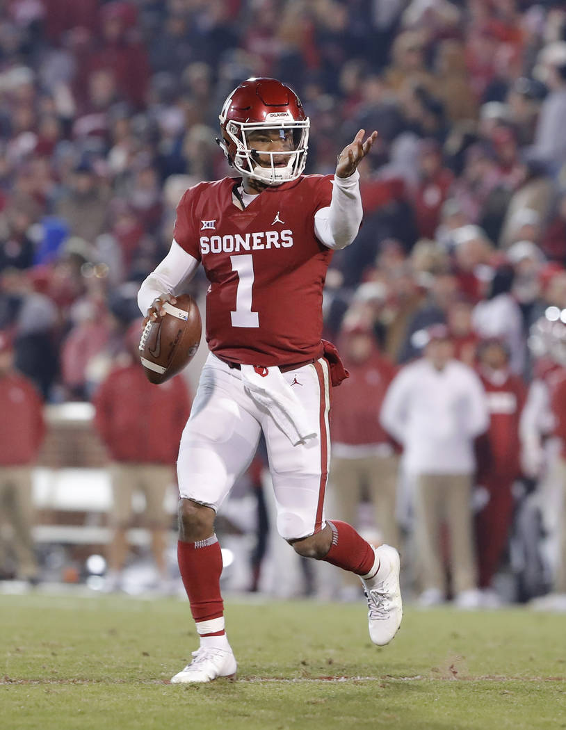 Oklahoma quarterback Kyler Murray (1) gestures to his team during a play against Kansas during ...