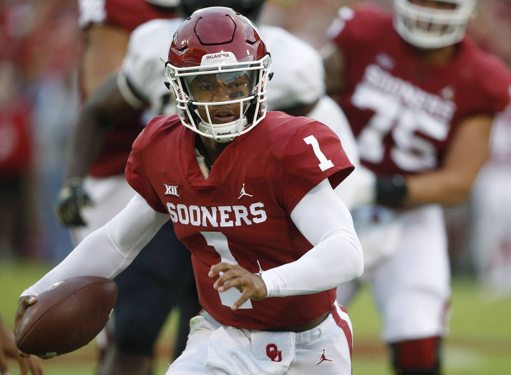 FILE - In this Sept. 22, 2018, file photo, Oklahoma quarterback Kyler Murray (1) carries for a ...