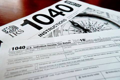 FILE- This Feb. 13, 2019, file photo shows multiple forms printed from the Internal Revenue Ser ...