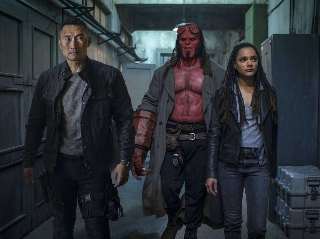 This image released by Lionsgate shows, from left, Daniel Dae Kim, David Harbour and Sasha Lane ...
