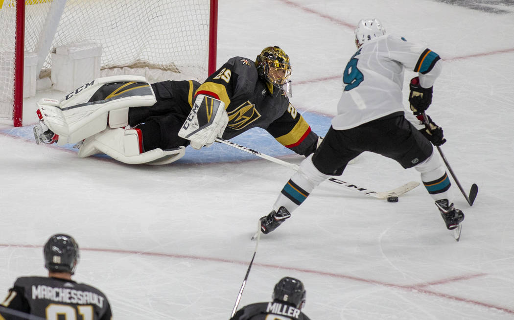 Golden Knights goaltender Marc-Andre Fleury (29) saves a shot on goal by San Jose Sharks left w ...