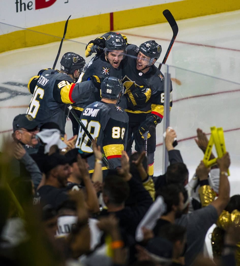 "Golden Knights players celebrate the ""hat trick"" by their right wing Mark Stone (61) ..."