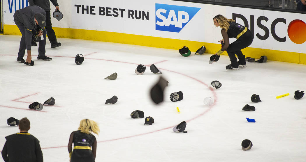 Hats are tossed onto the ice in honor of Golden Knights right wing Mark Stone (61) scoring his ...