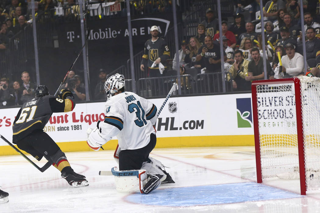 Golden Knights right wing Mark Stone (61) scores a goal past San Jose Sharks goaltender Martin ...