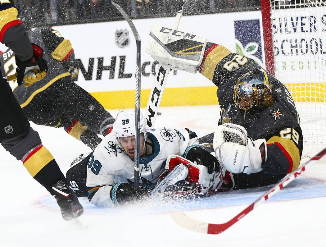 San Jose Sharks center Logan Couture (39) crashes into Golden Knights goaltender Marc-Andre Fle ...