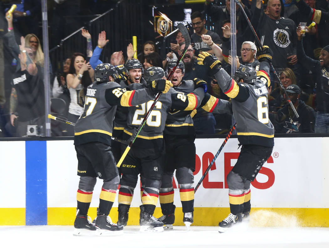 Golden Knights players celebrate a hat trick by Golden Knights right wing Mark Stone, second fr ...