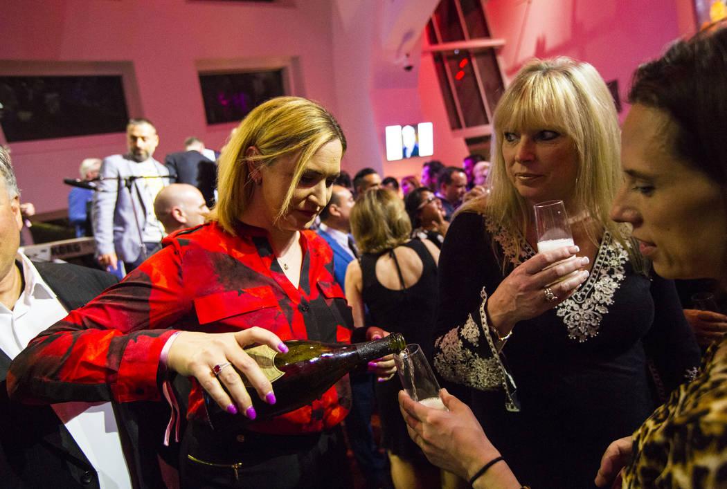 Kristin Seifert, left, pours Dom Perignon for attendees during Bubble-Licious, the UNLVino kick ...